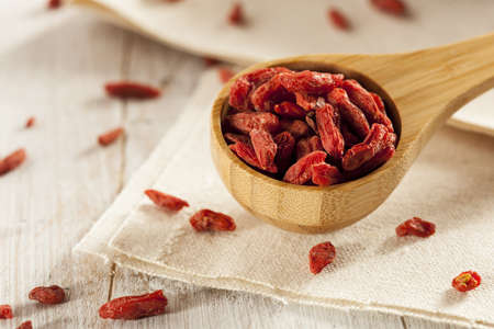 goji: Organic Dried Goji Berries against a background Stock Photo
