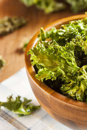 Homemade Organic Green Kale Chips with salt and oil Stock fotó