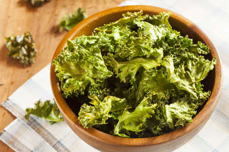 kale: Homemade Organic Green Kale Chips with salt and oil Stock Photo