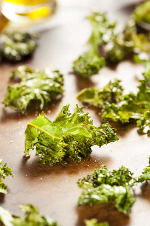 Homemade Organic Green Kale Chips with salt and oil Stock Photo