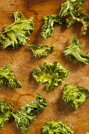 Homemade Organic Green Kale Chips with salt and oil photo