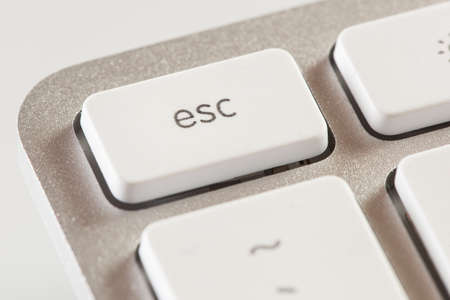 esc: Escape Button on a Grey Computer Keyboard with white keys for typing