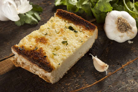 Homemade Crunchy Garlic Bread with butter and parsley photo