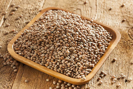 Dry Organic Brown Lentils against a background photo