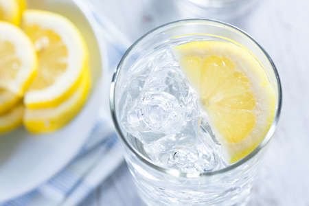 lemon water: Refreshing Ice Cold Water with Lemon ready to drink Stock Photo