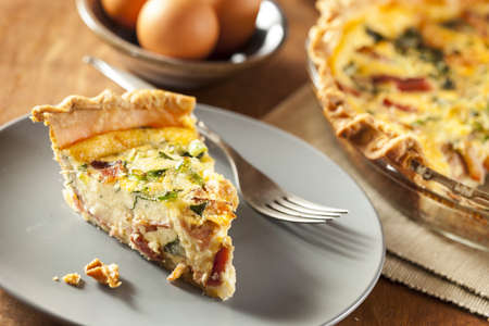 Homemade Spinach and Bacon Egg Quiche in a pie crust photo