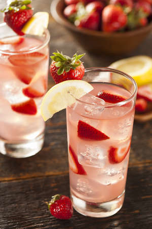 Refreshing Ice Cold Strawberry Lemonade on a background photo