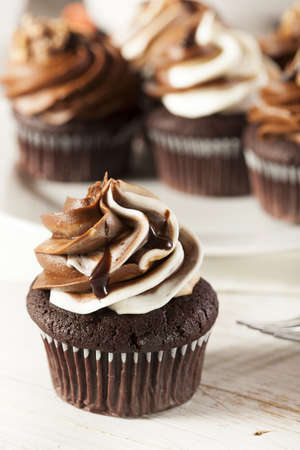 fattening: Homemade Chocolate Cupcake with chocolate frosting against a background