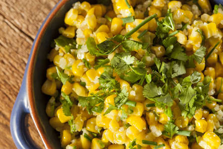 sweetcorn: Homemade Organic Mexican Corn Dish with cilantro, cheese, and chives