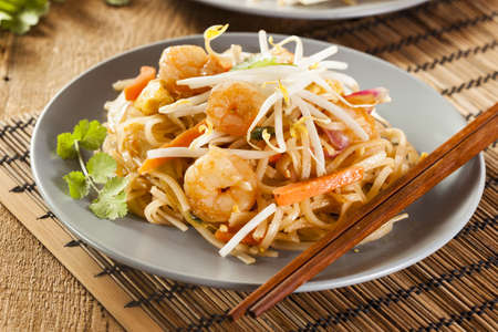 Homemade Asian Pad Thai with shrimp and cilantro photo