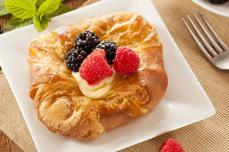 Homemade Gourmet Danish Pastry with berries and icing photo