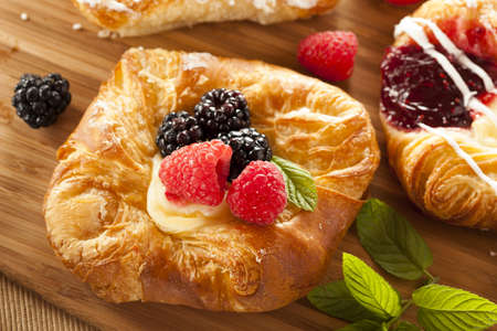 fattening: Homemade Gourmet Danish Pastry with berries and icing Stock Photo
