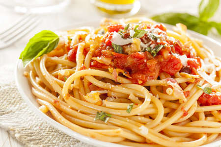 Homemade Bucatini Amatriciana Pasta with sauce and basil Stock Photo