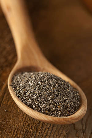 hispanica: Organic Dry Black and White Chia Seeds against a background