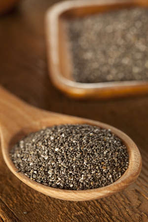 flax seed: Organic Dry Black and White Chia Seeds against a background
