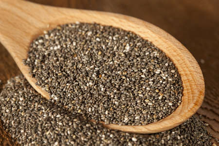 Organic Dry Black and White Chia Seeds against a background photo