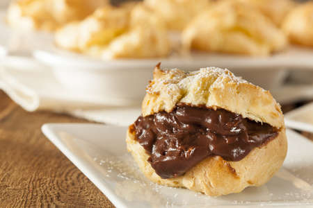Homemade Chocolate Cream Puffs against a background
