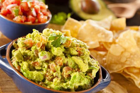 Homemade Organic Guacamole made with avacados and Tortilla Chips photo