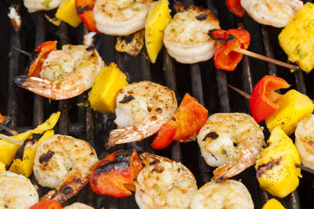 prawn skewers: Homemade Shrimp Shish Kebab with peppers on a grill Stock Photo