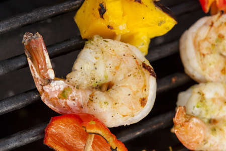 shish: Homemade Shrimp Shish Kebab with peppers on a grill Stock Photo