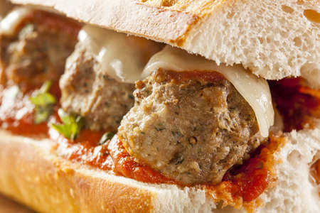 sub: Homemade Spicy Meatball Sub Sandwich with Marinara Sauce and Cheese Stock Photo