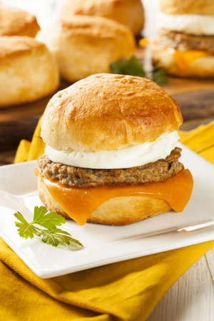 Homemade Egg Sandwich with Sausage and Cheese on a Roll