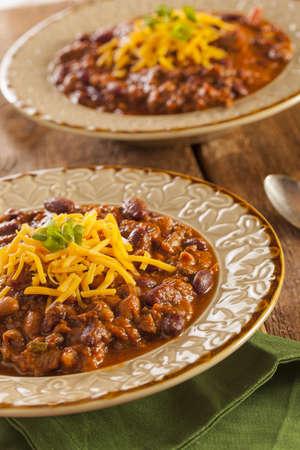con: Spicy Homemade Chili Con Carne Soup in a Bowl