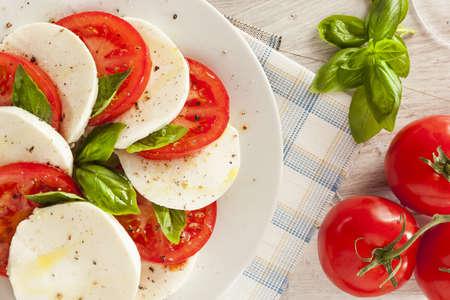 Homemade Organic Caprese Salad with Tomato and Mozzarella photo