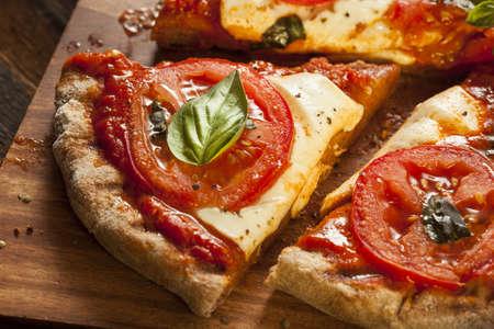 margarita: Organic Homemade Margarita Pizza with Basil and Mozarella Stock Photo