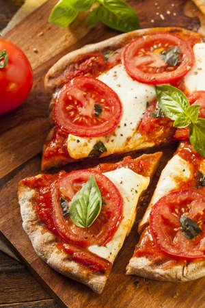 margarita pizza: Organic Homemade Margarita Pizza with Basil and Mozarella Stock Photo