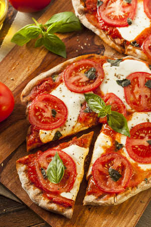 pizzas: Organic Homemade Margarita Pizza with Basil and Mozarella Stock Photo
