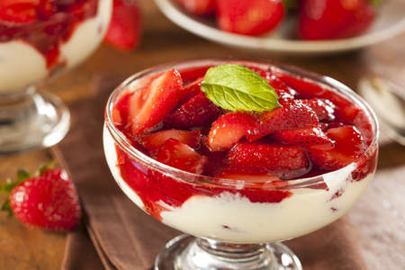 Fresh Organic Strawberry Fruit Parfait with a Mint Leaf