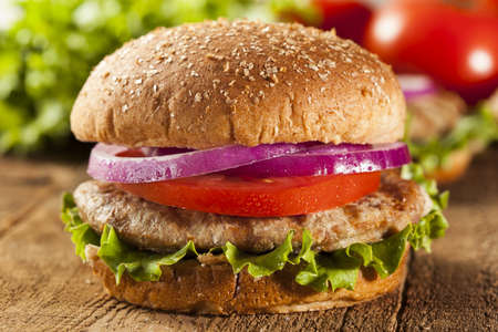Homemade Turkey Burger on a Bun with Lettuce and Tomato Stock Photo
