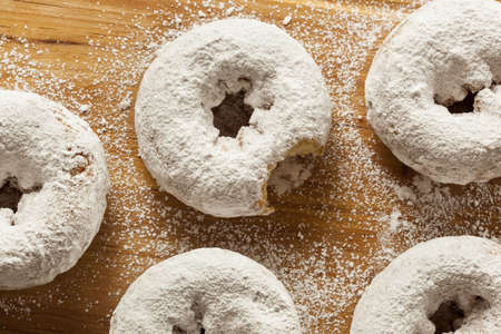 donut shape: White Homemade Powdered Donuts on a Background Stock Photo