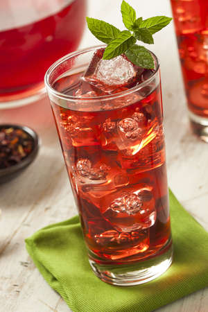 Cold Refreshing Berry Hibiscus Iced Tea with Mint photo