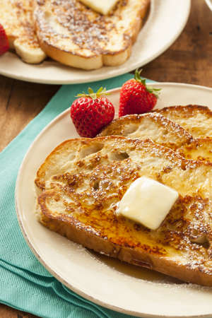 Homemade French Toast with Butter and Powdered Sugar photo