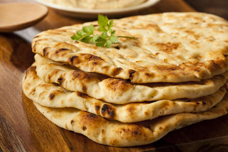 Homemade Indian Naan Flatbread made with Whole Wheat Stock Photo - 21711672