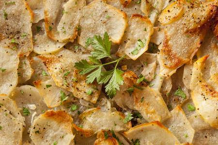 anna: Fresh Homemade Potatoes Anna with Green Parsley