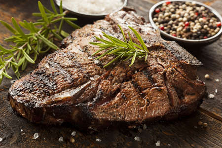 steak grill: Grilled BBQ T-Bone Steak with Fresh Rosemary