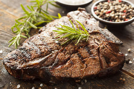 raw steak: Grilled BBQ T-Bone Steak with Fresh Rosemary