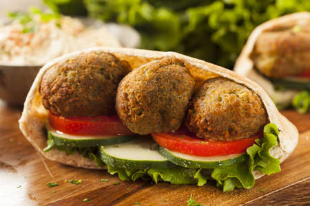 Organic Falafel in a Pita Pocket with Tomato and Cucumber Stock Photo - 22037259