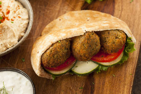 arabic food: Organic Falafel in a Pita Pocket with Tomato and Cucumber