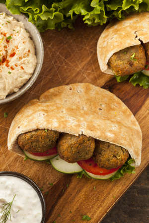 Organic Falafel in a Pita Pocket with Tomato and Cucumber Stock Photo - 22037263