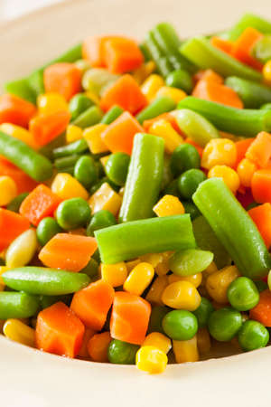 Steamed Organic Vegetable Medly  with Peas, Corn, Beans, and Carrots photo