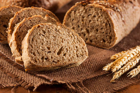 carbohydrates: Fresh Homemade Whole Wheat Bread on a Background Stock Photo