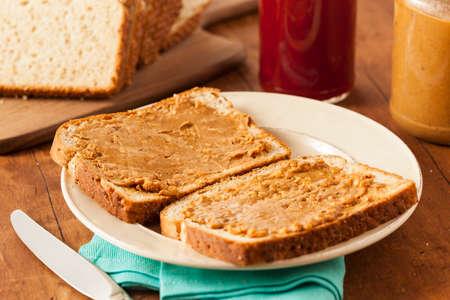 sandwich spread: Homemade Chunky Peanut Butter Sandwich on Whole Wheat Bread