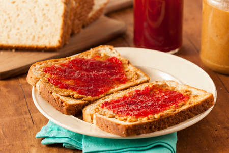 peanut butter and jelly: Homemade Peanut Butter and Jelly Sandwich on Whole Wheat