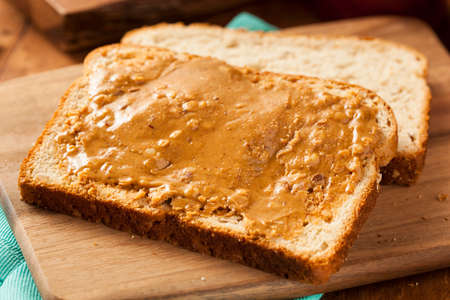 smooth: Homemade Chunky Peanut Butter Sandwich on Whole Wheat Bread