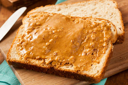 peanut butter and jelly sandwich: Homemade Chunky Peanut Butter Sandwich on Whole Wheat Bread