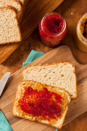 strawberry jelly: Homemade Peanut Butter and Jelly Sandwich on Whole Wheat